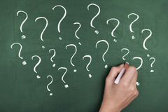 question-marks-confusion-hand-writing-chalkboard-45761846
